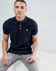 Abercrombie & Fitch stretch slim fit pique polo icon logo in navy - Navy