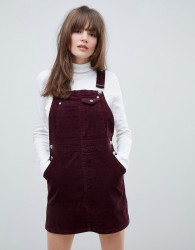 ASOS DESIGN cord dungaree dress in oxblood - Red
