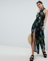 ASOS DESIGN cross front jumpsuit with wrap leg detail in dark leaf print - Multi