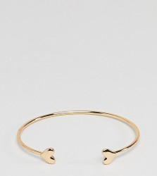 ASOS DESIGN Curve cuff bracelet with heart detail in gold - Gold