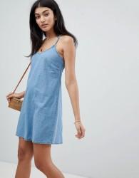 ASOS DESIGN denim slip dress with low back in midwash blue - Blue