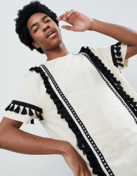 ASOS DESIGN festival relaxed longline t-shirt with aztec taping and tassels in ecru - White