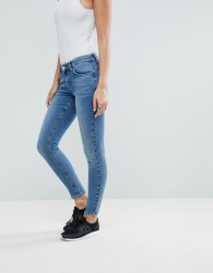 ASOS DESIGN Lisbon mid rise skinny jeans in vienna mid wash blue - Blue