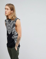 ASOS DESIGN longline sleeveless t-shirt with dropped armhole with paisley skull print & acid wash - Black