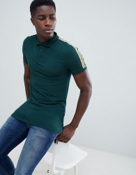 ASOS DESIGN muscle polo shirt with contrast shoulder taping in green - Green