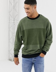 ASOS DESIGN oversized sweatshirt in khaki interest fabric with reverse panel - Green