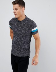 ASOS DESIGN polo shirt with contrast sleeve panels in black inject fabric - Black