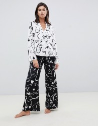 ASOS DESIGN satin mono face print double breasted shirt and trouser pyjama set - White