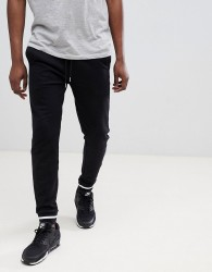ASOS DESIGN skinny joggers in black with contrast tipping - Black