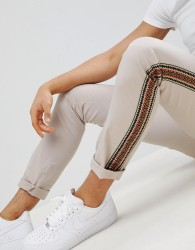 ASOS DESIGN skinny trousers in beige with aztec side taping - Beige