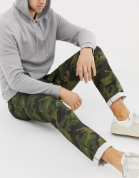 ASOS DESIGN slim trousers in camo - Green