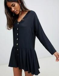 ASOS DESIGN swing trapeze mini dress with pep hem - Black