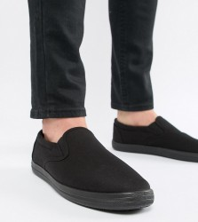 ASOS DESIGN Wide Fit slip on plimsolls in black canvas - Black