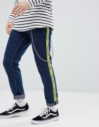 ASOS Slim Jeans In Indigo With Side Stripe Text - Blue
