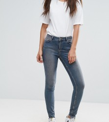 ASOS TALL LISBON Skinny Mid Rise Jeans in Dita Tinted Mid Wash with Reverse Stepped Hem - Blue