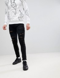 Criminal Damage Muscle Fit Ripped Jeans In Black - Black