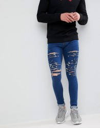 Criminal Damage Muscle Fit Ripped Jeans In Mid Wash - Blue