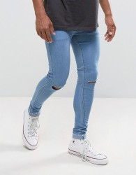 Criminal Damage Muscle Fit Super Skinny Jeans With Knee Rips And Raw Hem - Blue