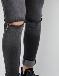 Criminal Damage Skinny Jeans in Show Wash Ripped - Blue