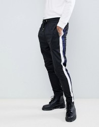 Criminal Damage skinny joggers in black with blue side stripe - Black