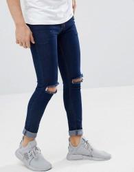Criminal Damage Super Skinny Jeans in Indigo Ripped - Navy