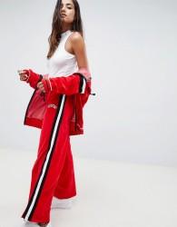 Criminal Damage wide leg velour track pants with side stripe - Red