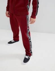 DC Shoes Joggers with Logo Taping in Burgundy - Red