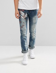 Illegal Club Skinny Jeans In Midwash Blue With Embroidery - Blue