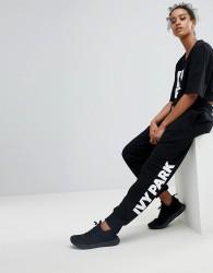 Ivy Park Logo Sweatpants In Black - Black