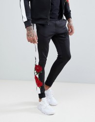 Kings Will Dream Skinny Joggers With Rose Print Side Stripes - Black