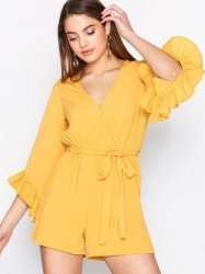 New Look Plain Ruffle Wrap Playsuit Playsuits Mustard