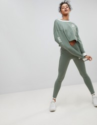 Nike Archive Leggings In Green With Piped Trim - Green