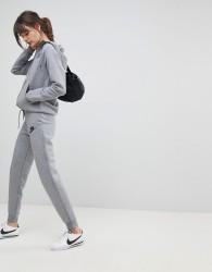 Nike Rally Slim Fit Joggers In Grey - Grey