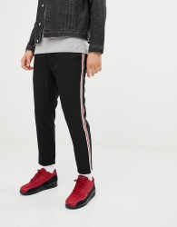 Pull&Bear trousers in black with red and white side stripe - Black