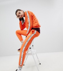 Puma Exclusive To ASOS Taped Side Stripe Track Pants In Orange - Orange