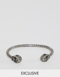 Reclaimed Vintage inspired bangle with skull in burnished silver exclusive at ASOS - Silver