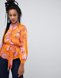 River Island floral print key hole River Island key hole blouse with tie waist in orange floral - Orange