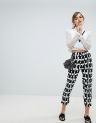 Sister Jane Cigarette Trousers With Front Stripe In All Over Llama Print - Black