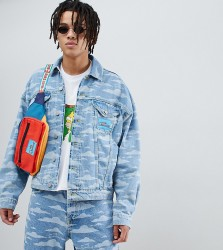 The Simpsons x ASOS DESIGN denim jacket with cloud burnout - Blue
